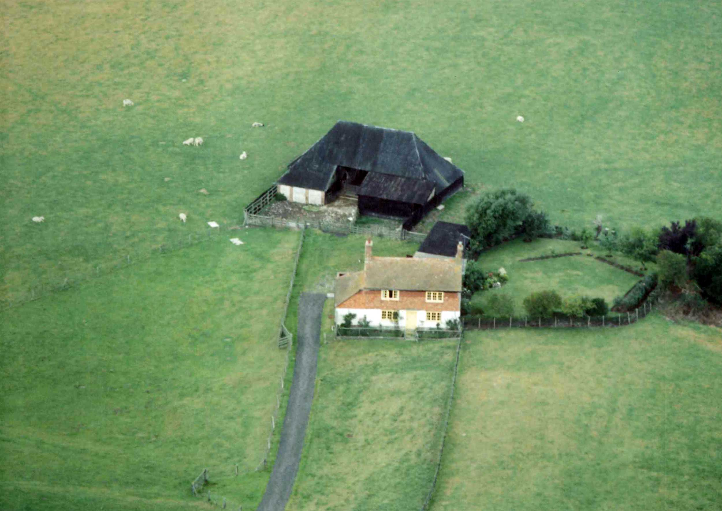The old Coldharbour Cottage and barn