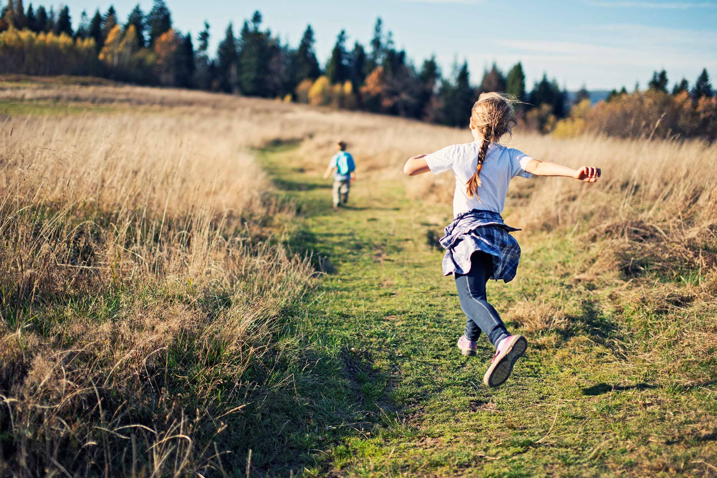Kids running in the countryside